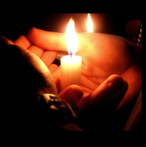 hands-holding-a-candle